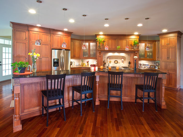redone wood paneled kitchen with countertop bar