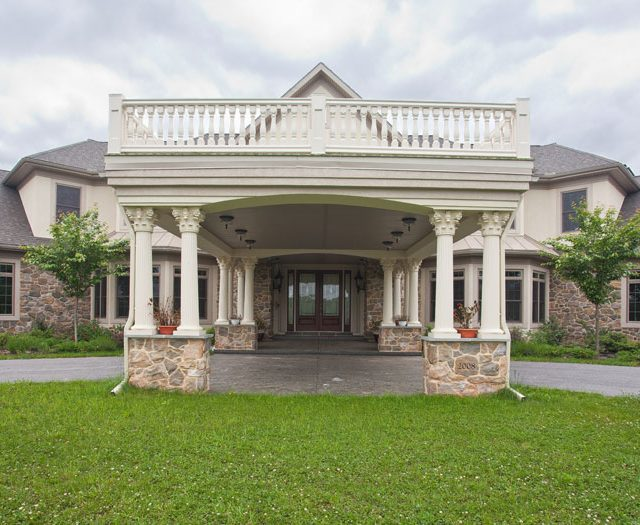 large stone portico with overlooking deck